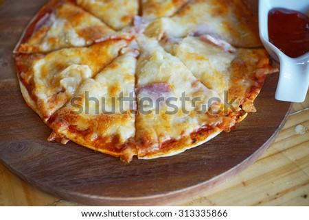 soft focus of  pizza on wood, homemade