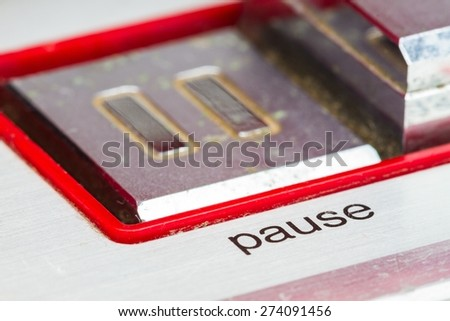 soft focus pause button, focusing on the word pause, retro concept - stock photo