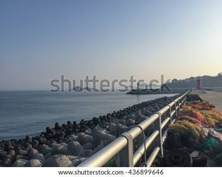 Soft focus Pier in South Korea sea with beautiful blue sky and copy space area.The lighthouse and sea - stock photo