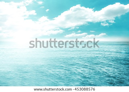 Soft focus surfing wave on summer ocean background. Blue water and sky bright. Nature wallpaper blur of sea daytime with sunlight. Abstract blurred view outdoor window backdrop.