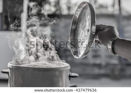 Soft focus The steam from the rice cooker - stock photo