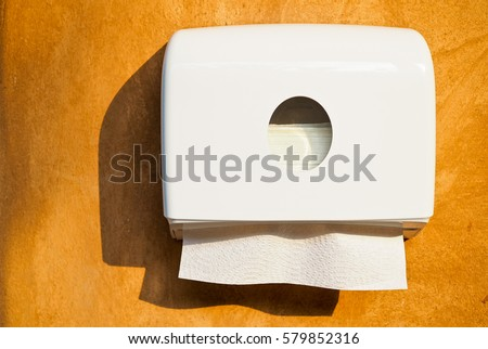 soft focus tissues paper towel dispenser on orange wall - Paper Towel Dispenser