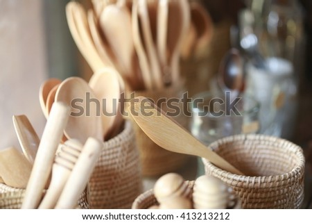 soft focus wood spoon nd knife ,wood spoon made by hand craft for clean and natural touch on food, Souvenir shop