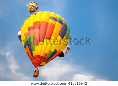 soft-focused hot-air balloons on blue sky background