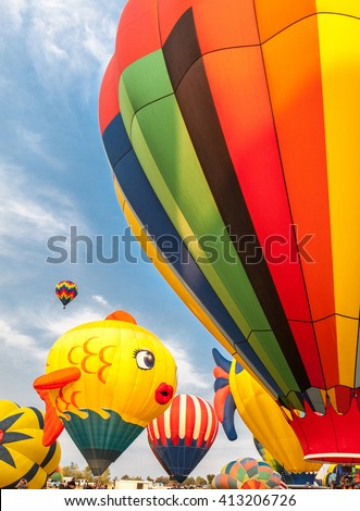 soft-focused hot-air balloons with blue sky and clouds background