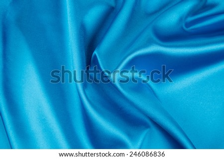 Soft folds of light blue silk texture. Whole background. - stock photo
