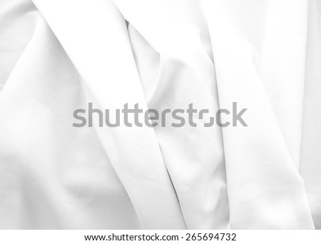 soft folds of white cloth as background - stock photo