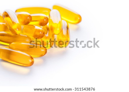 Soft gels pills with Omega-3 oil on white