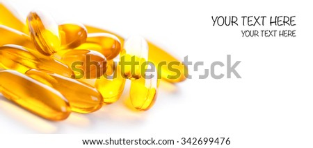 Soft gels pills with Omega-3 oil on white - stock photo