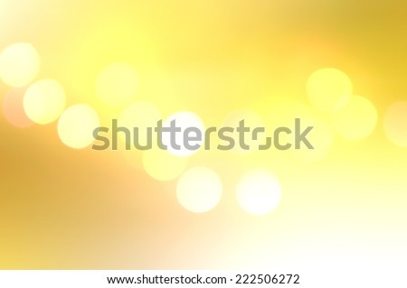 soft glowing golden yellow bokeh background in landscape (horizontal) orientation. - stock photo