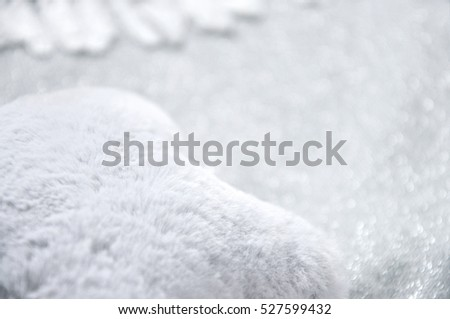 Soft grey puffy fabric with glitter background