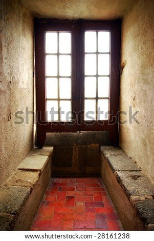 Soft light entering from a old window of a medieval house - stock photo