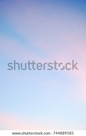 Soft light pink clouds at blue sky. Soft and fluffy light pink clouds at background blue sky in October morning.
