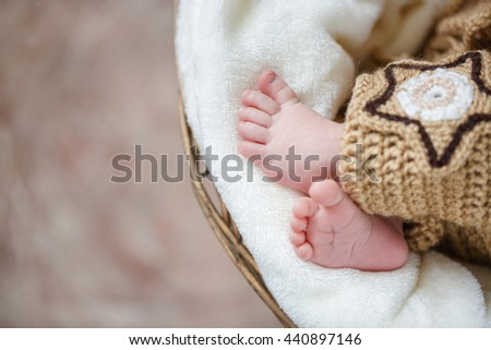 Soft newborn baby feet against a pink blanket. Photo of newborn baby feet. Baby Foot - stock photo