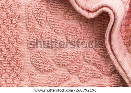 Soft orange texture of bath towel folded with blank space - stock photo