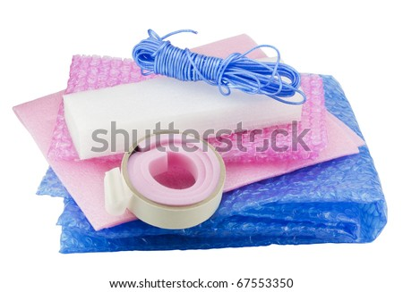 Soft packing material kit - film, foam rubber, sticky tape, rope. Isolated on white,  with patch - stock photo