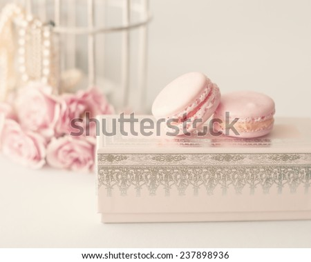 Soft pastel vintage still life with macaroons and roses - stock photo