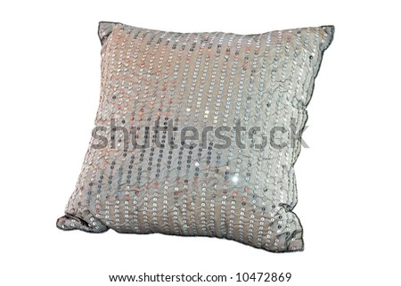Soft pillow with silver metal decoration isolated