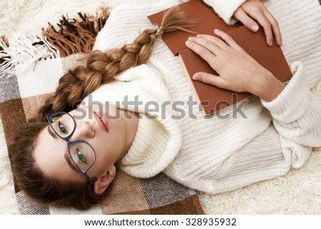 Soft portrait of cute  teenage girl reading book at home - stock photo