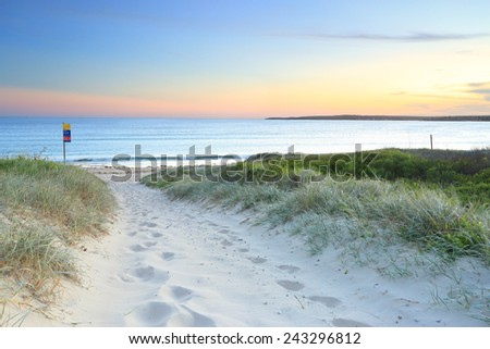 Soft sandy track leading down to Greenhills Beach Bate Bay at sundown.  South Sydney Australia. - stock photo