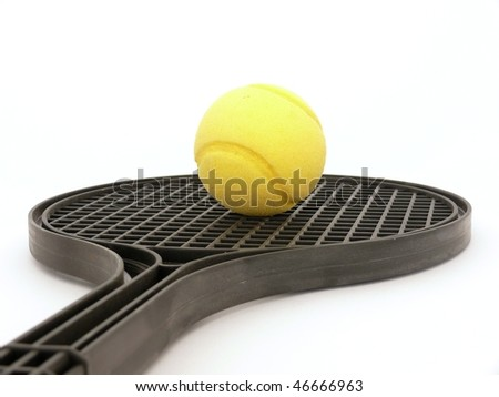 Soft tennis ball and racket isolated on white - stock photo