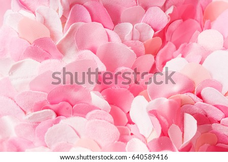 Soft textile pink petals composition. Flower blossom wallpaper, top view