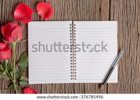 Soft tone filter : Blank notebook with red rose  on wood background