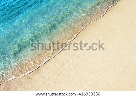 Soft wave of blue ocean on sandy beach. Background. - stock photo