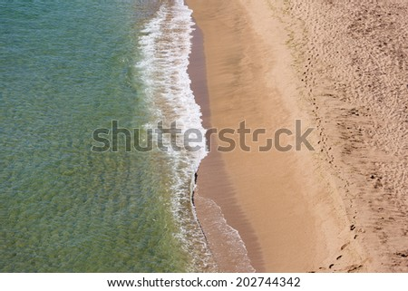 Soft wave of the sea on the sandy beach  - stock photo