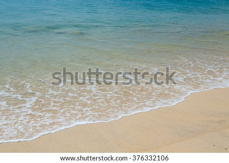 Soft wave of the sea on the sandy beach at Thailand. - stock photo