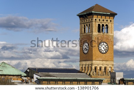Soft white clouds surround the old City Hall Building in Tacoma Washington, United States - stock photo