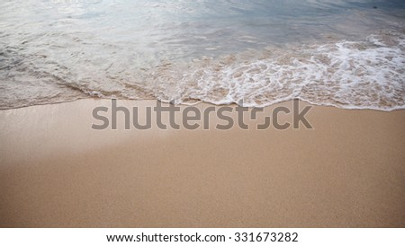 Soft white wave of the sea on the sandy beach at Phuket, Thailand. Copy space for some text. - stock photo
