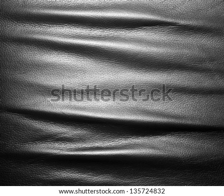 Soft wrinkled black leather. Texture or background with copyspace, high resolution - stock photo