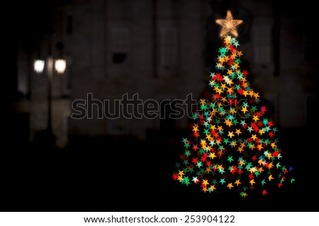 softly focused and blurred holiday and christmas lights on a christmas tree - stock photo