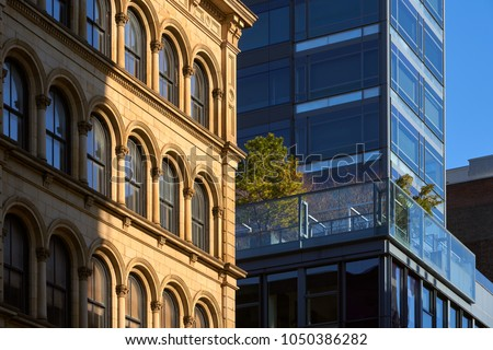 soho building facades contrasting architectural styles stock photo