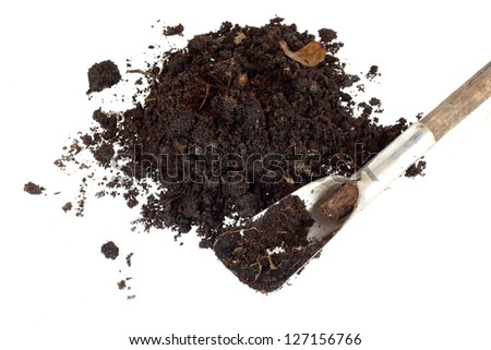 soil and little shovel isolated - stock photo