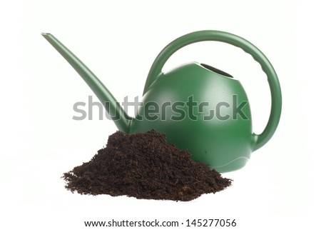 Soil and watering can on white background