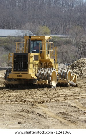 Soil Compactor at Construction Site - stock photo