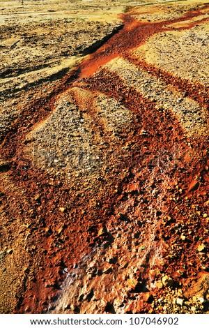 Soil pollution of a copper mine exploitation - stock photo