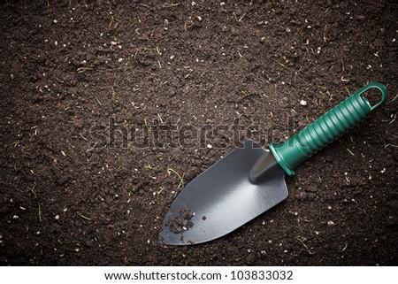 Soil with shovel - stock photo