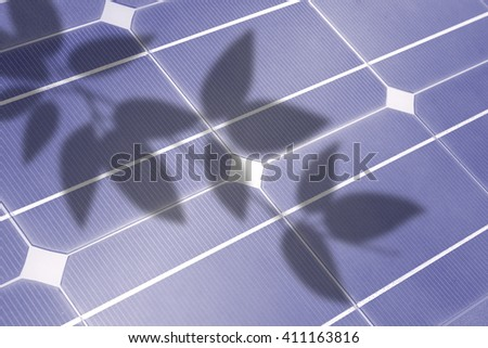 solar cell, detail with shadows of leaves  - stock photo