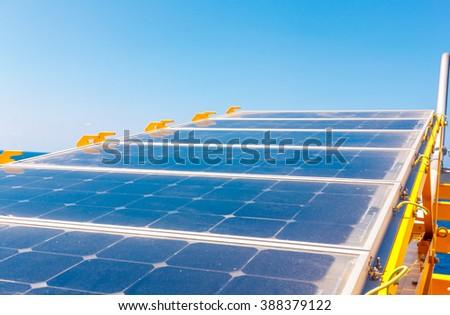 Solar cell on offshore platform with blue sky.