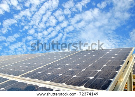 Solar cell over the blue sky - stock photo