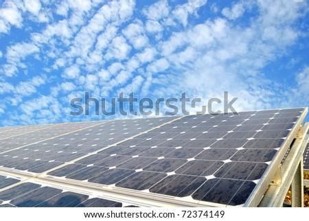 Solar cell over the blue sky - stock photo