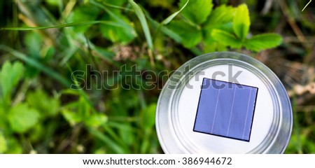solar cell panel on lanterns for the garden on a green glade - stock photo