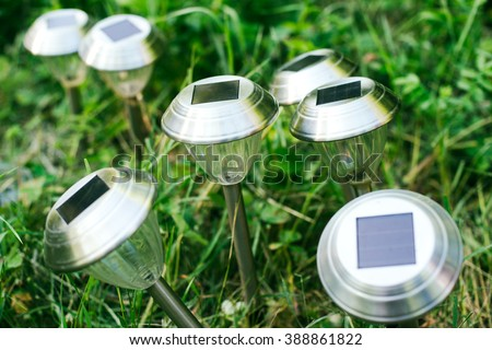 solar cell panel on lanterns for the garden on a green glade