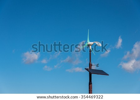Solar cell with wind turbine pole
