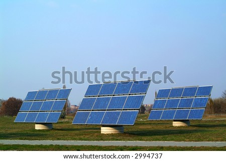 Solar cells against blue sky - stock photo