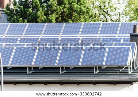 Solar cells, photovoltaic system on a flat roof. - stock photo