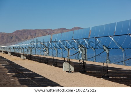 Solar collection panels at a solar power plant in the Mojave Desert in California - stock photo